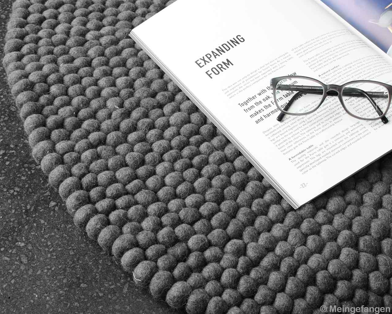 book dark grey felted carpet balls glasses book 1
