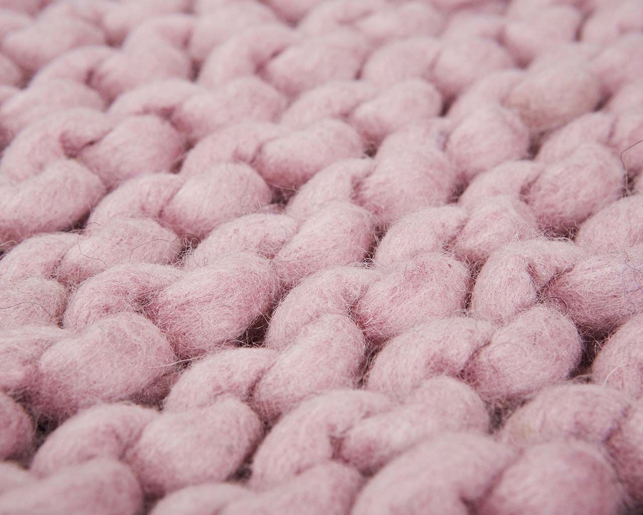 braided soft pink woolen carpets