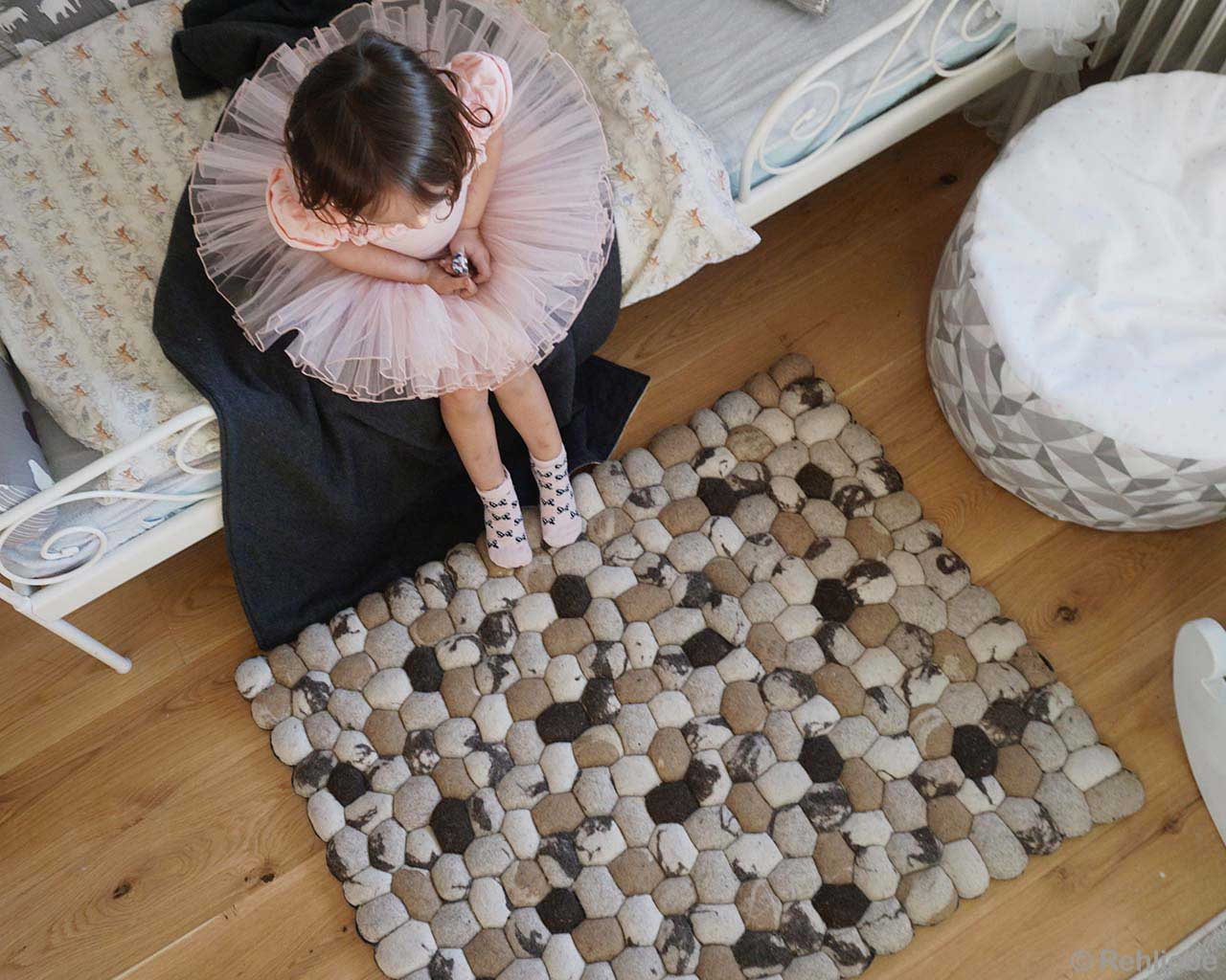 baby on bed indian beautiful felt ball bedroom rugs