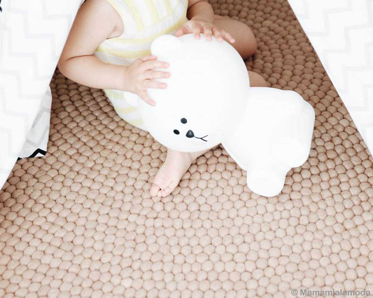 baby playing with stuffed snowman asian kids rugs