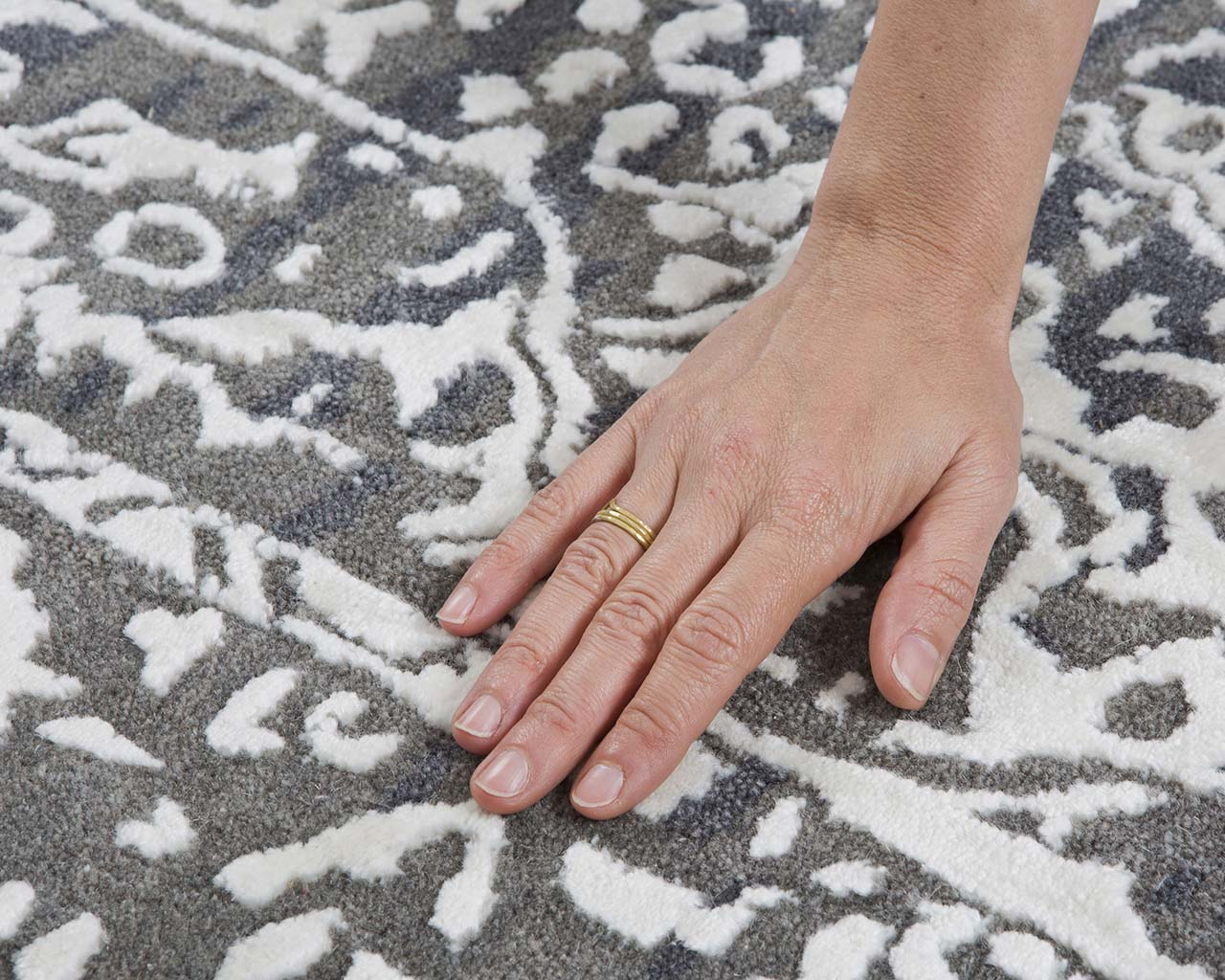 beautiful snow tufted hand with nail polish rugs online