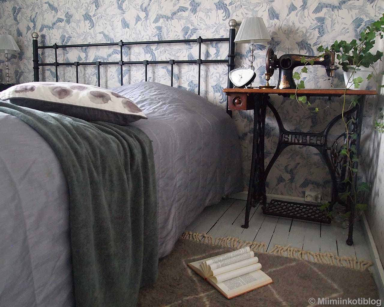 bed book and sewing machine modern accent rug