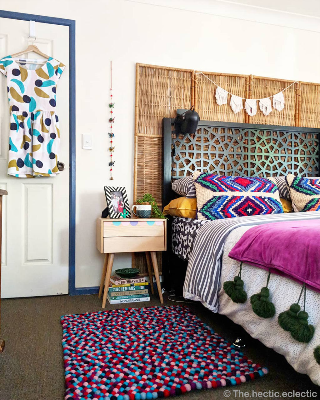 bed books and shirt in hanger from nepal contemporary floral rug