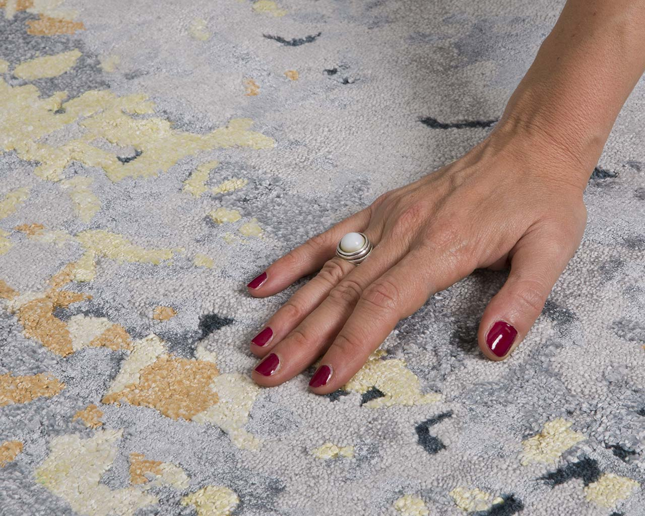 chocolate tufted hand with nail polish where to buy rugs