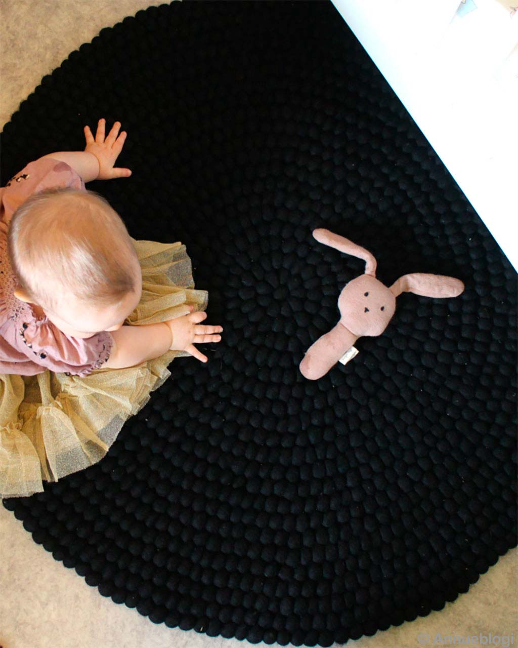 cute baby and stuffed toy made by nepalian modern accent rug