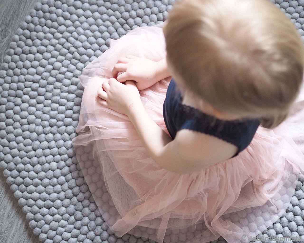 cute baby in pink frock nepal contemporary floral rug