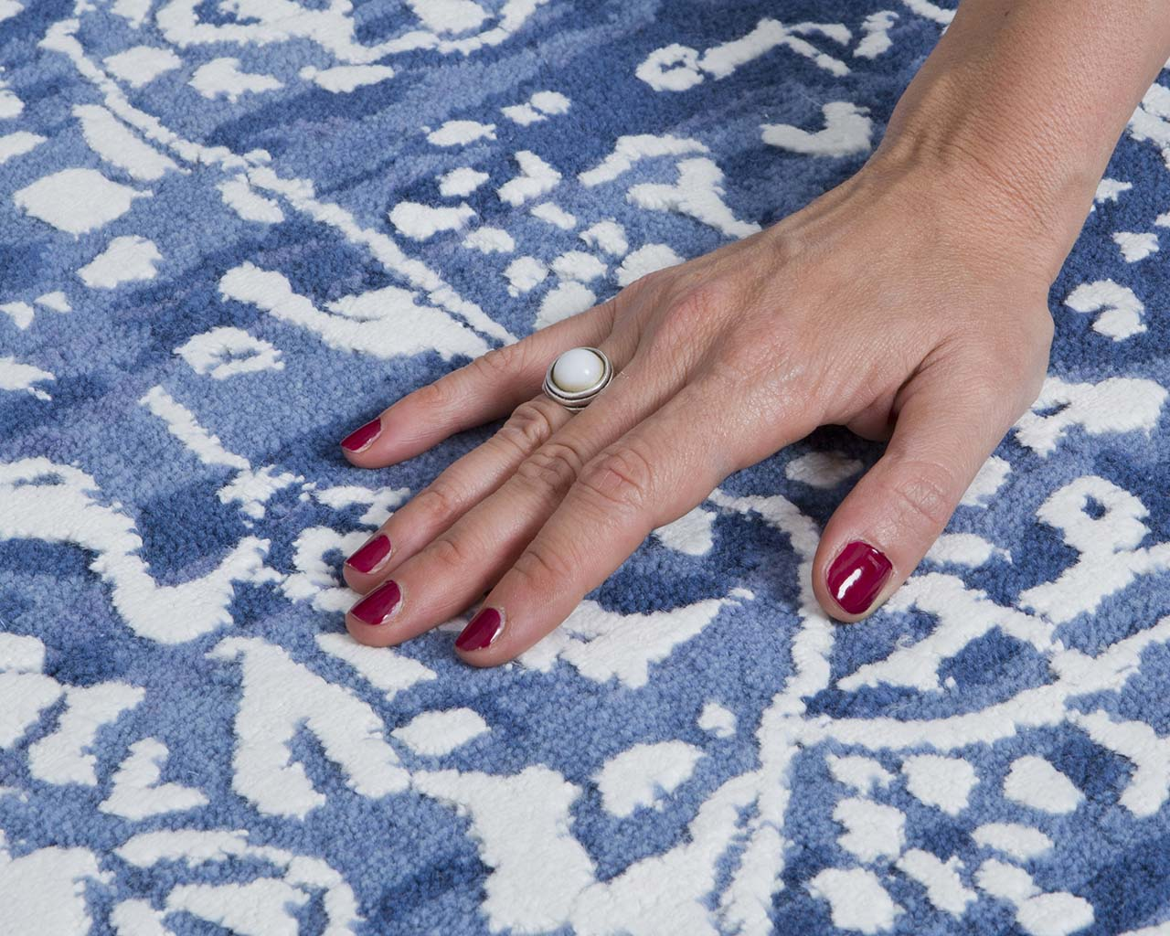 dark blue tufted hand with nail polish country area rugs