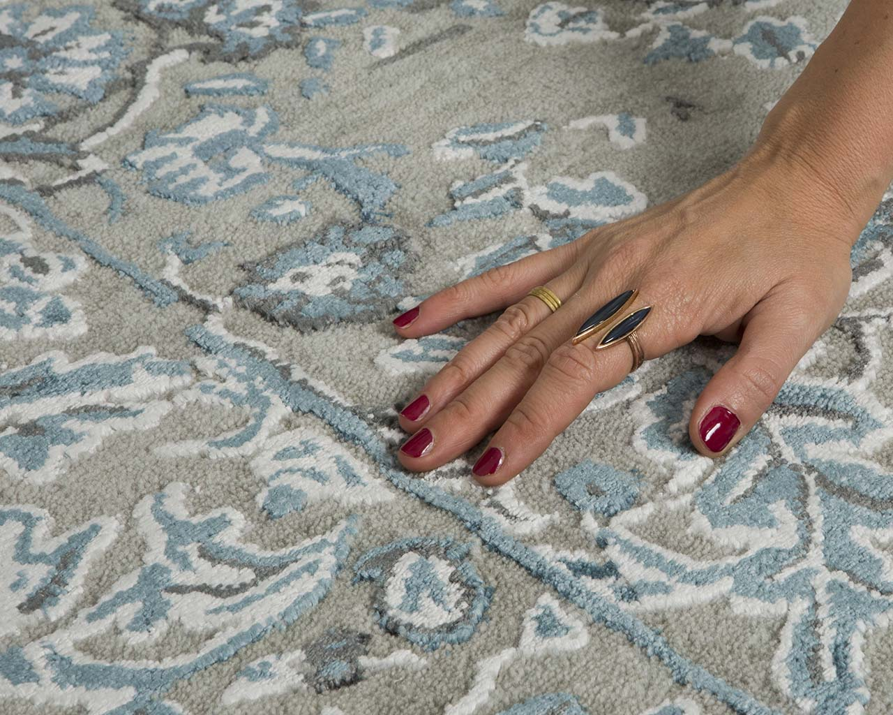 dark cyan tufted hand with nail polish area carpets online