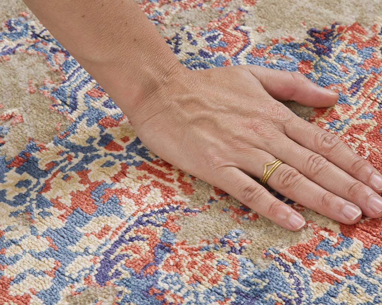 fresh light salmon hand with ring striped rug