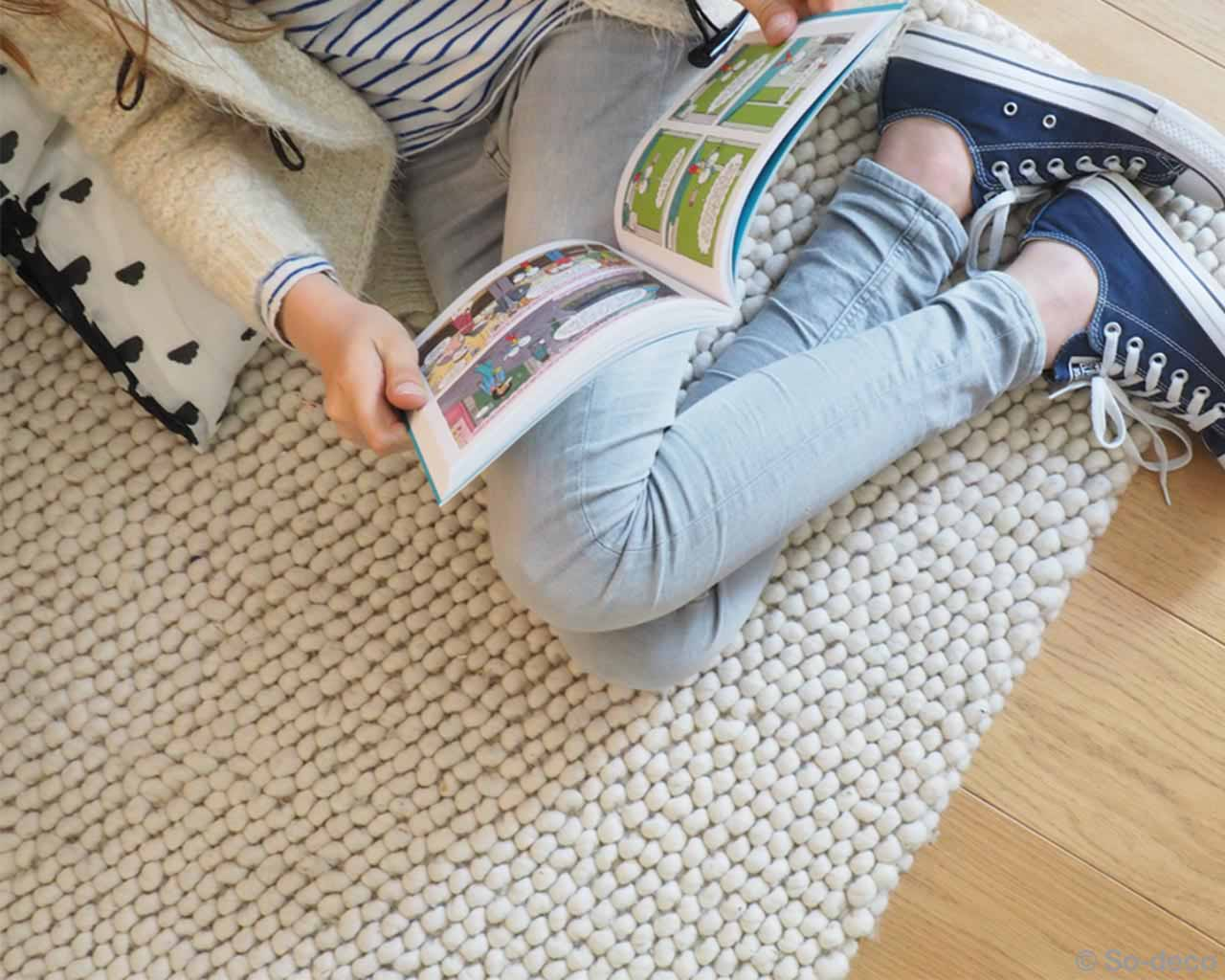 girl reading book designer white felt room rugs