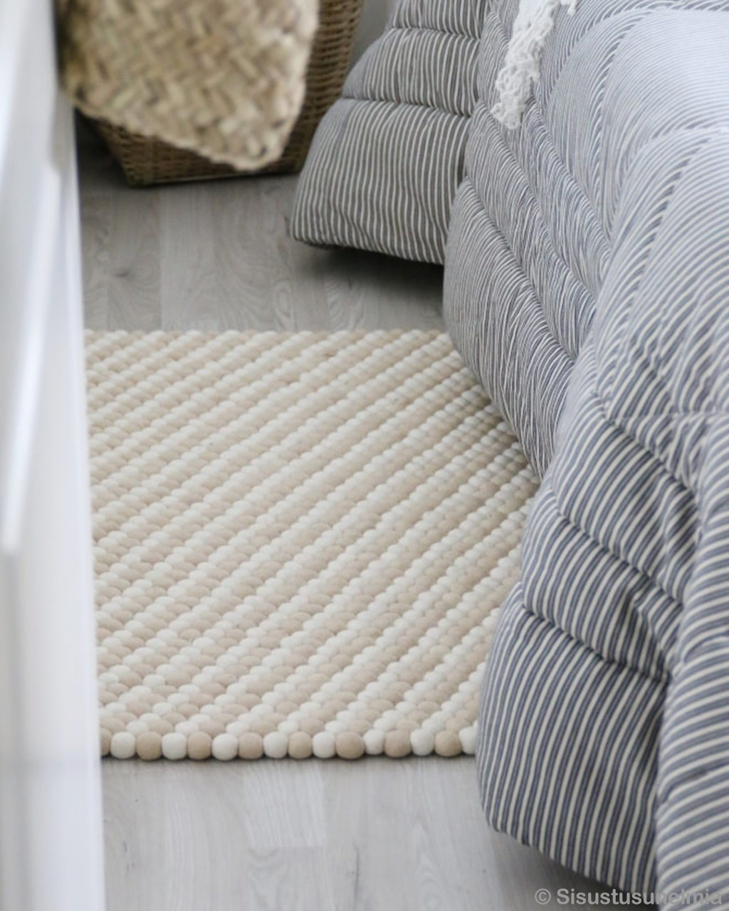 hand knotted bed with striped bed sheet made in nepal rugs