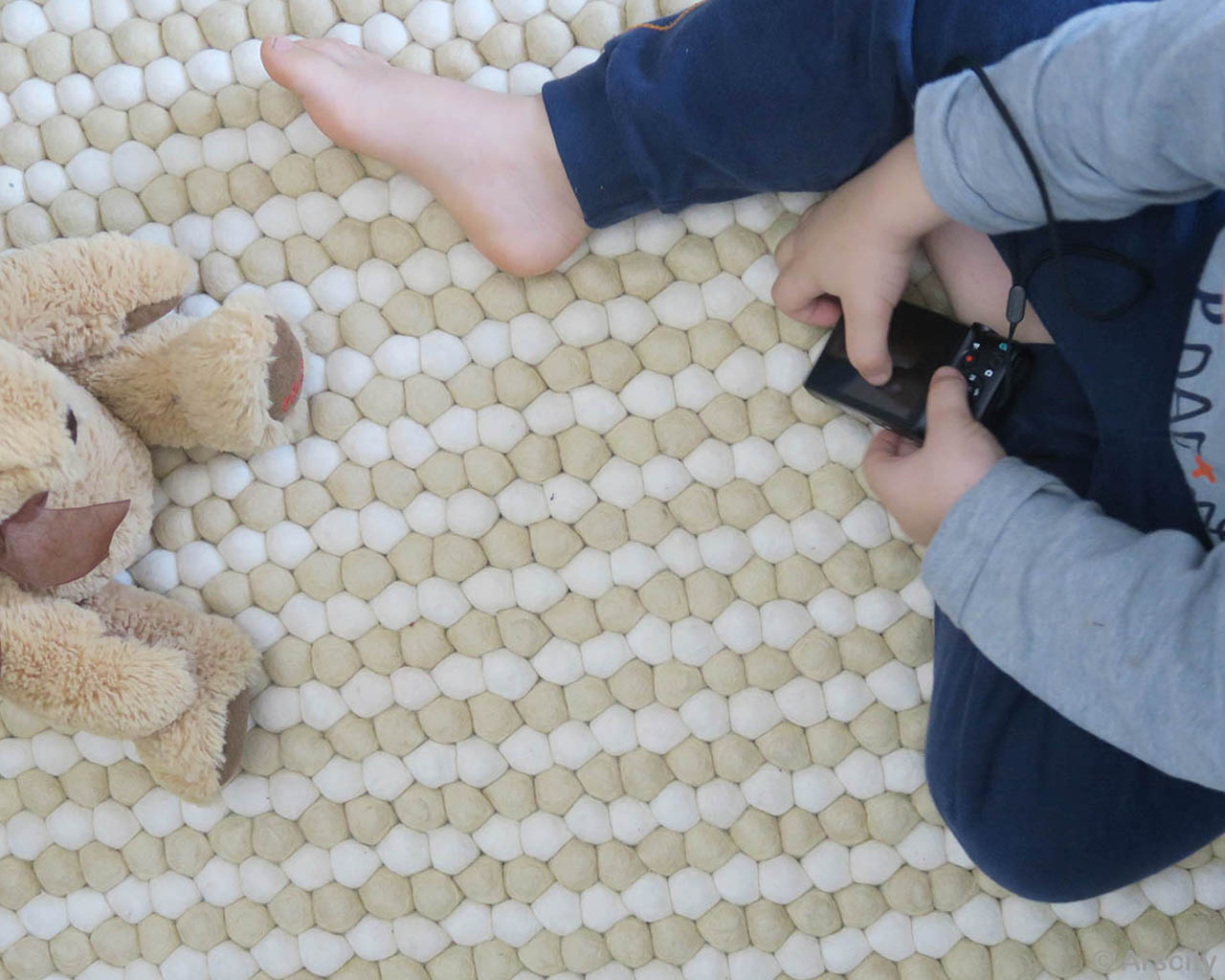 hand knotted black camera in kids hand nepalese rugs