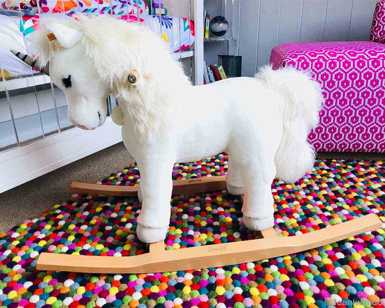 hand knotted stuffed horse and pink couch from nepal kitchen rugs