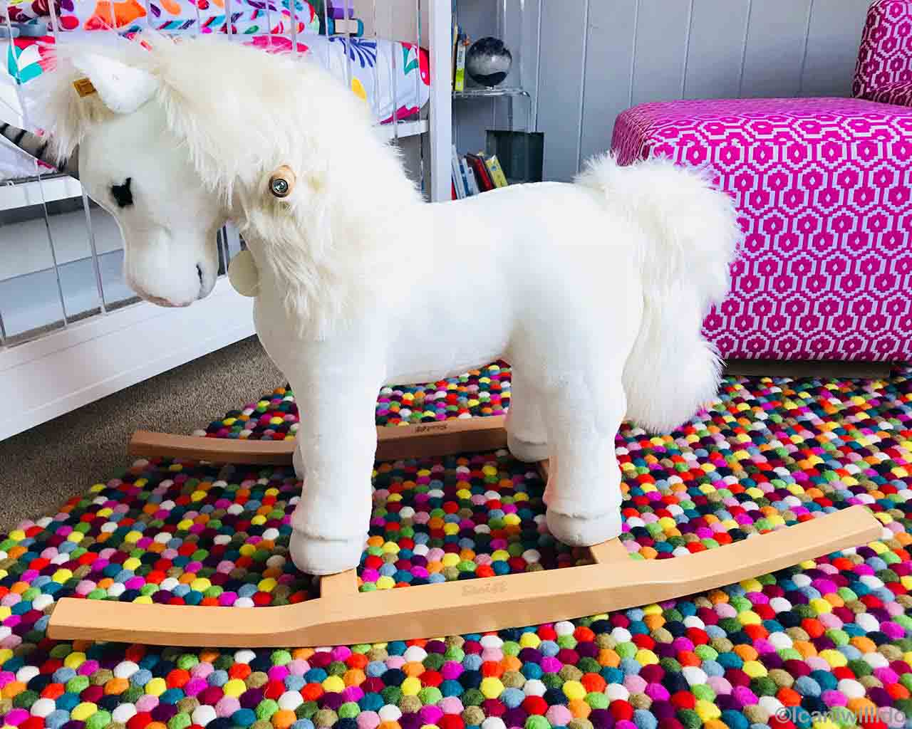 hand knotted white horse on wooden stand made by nepalian modern carpet