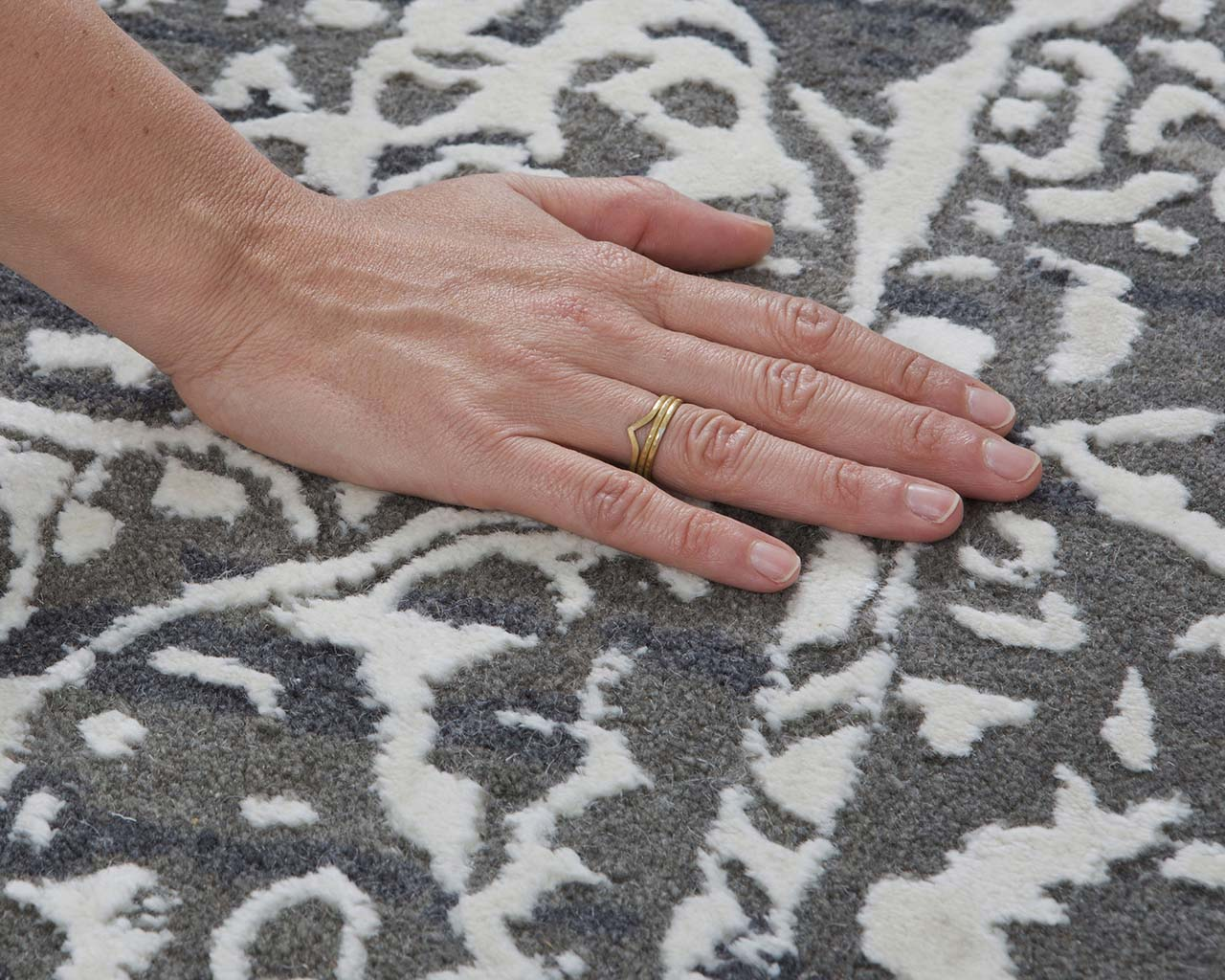 honey dew tufted hand with nail polish oriental rugs