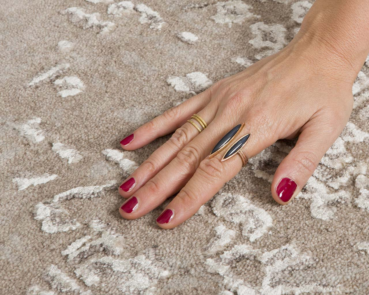 light gray fresh hand with red nail polish outdoor area carpets