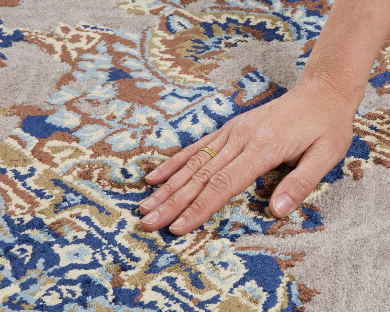 light gray fresh hand with ring furry rugs