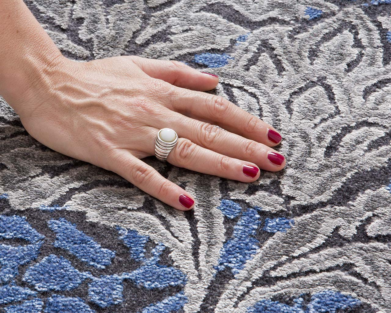 navy handmade hand with red nail polish accent rugs