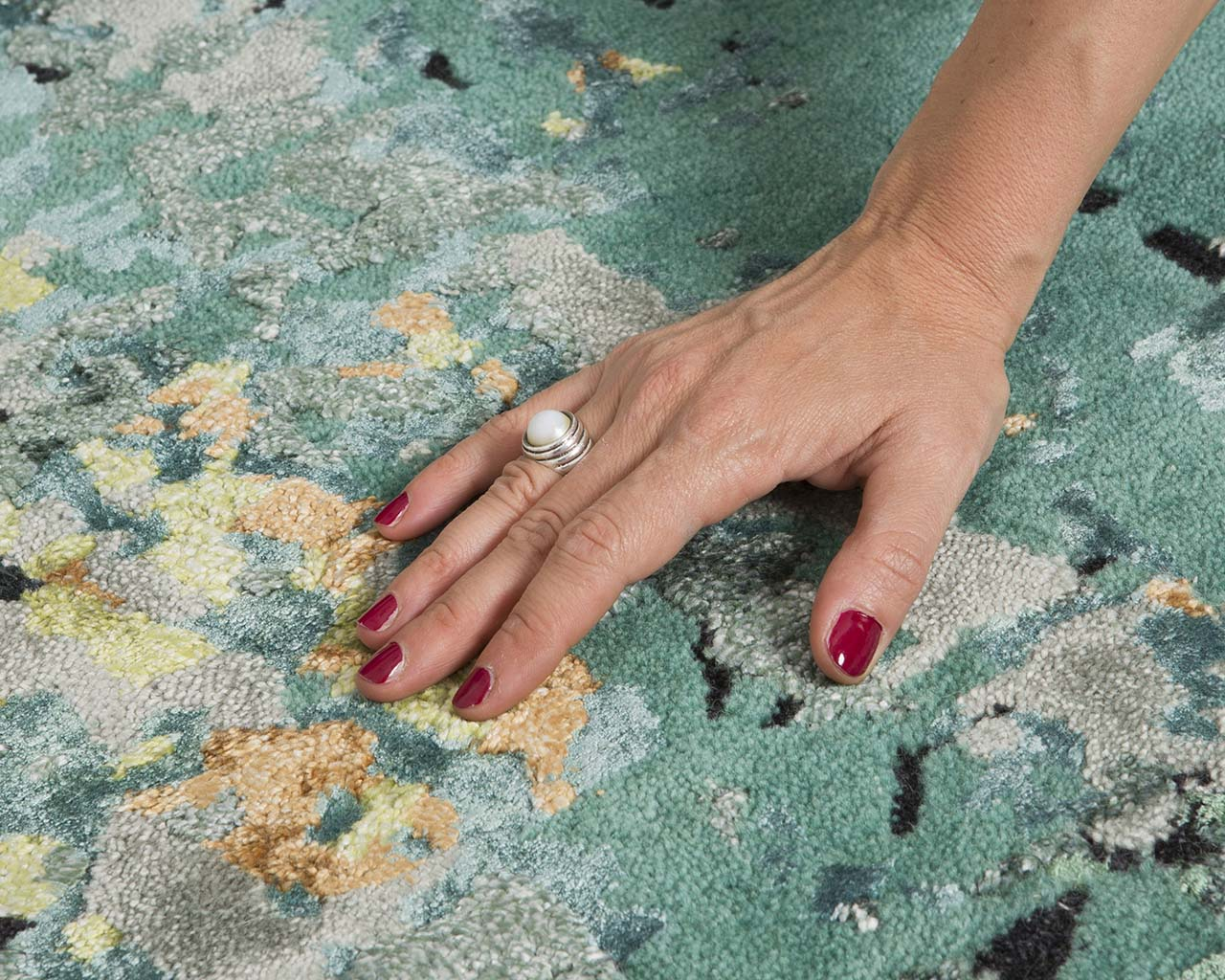 olive drab tufted hand with nail polish small area rugs