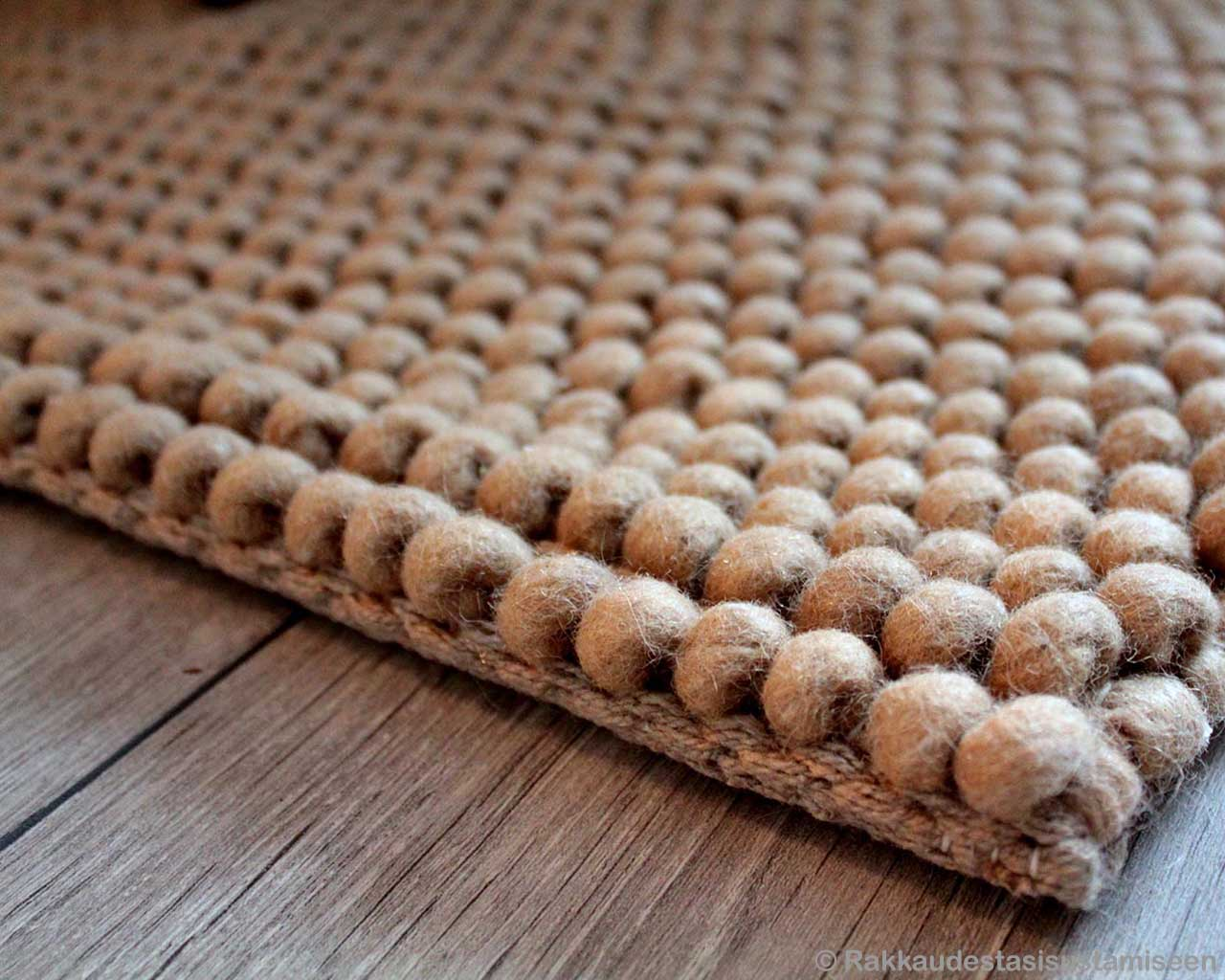 on wooden floor indian designer felt ball fluffy rugs