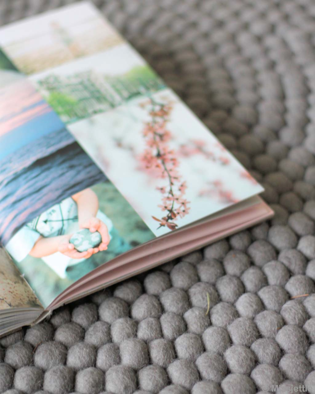 opened magazine with pictures made in nepal modern gray felt ball small rug