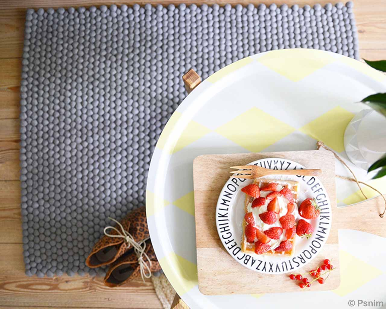 plate of strawberries and fork small rug