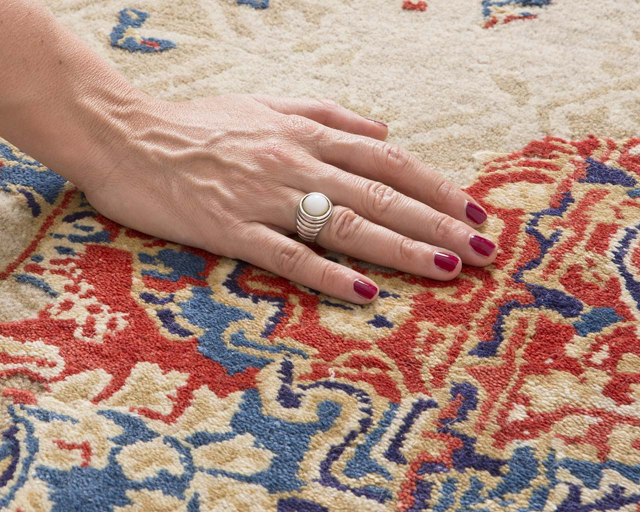 red oriental hand with red nail polish discount rugs online