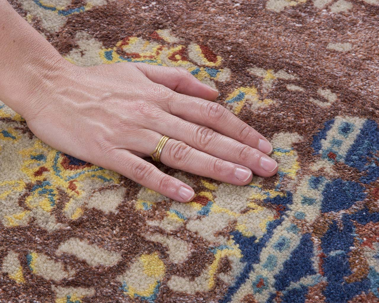 saddle brown oriental hand with ring authentic persian rugs