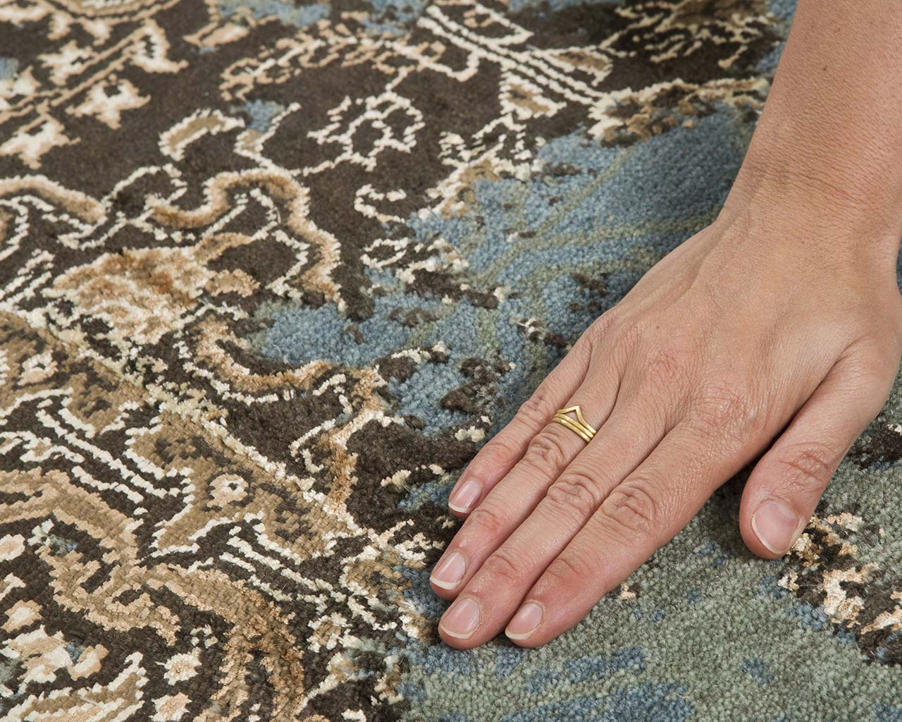 sandy brown hand knotted hand with ring patio rugs