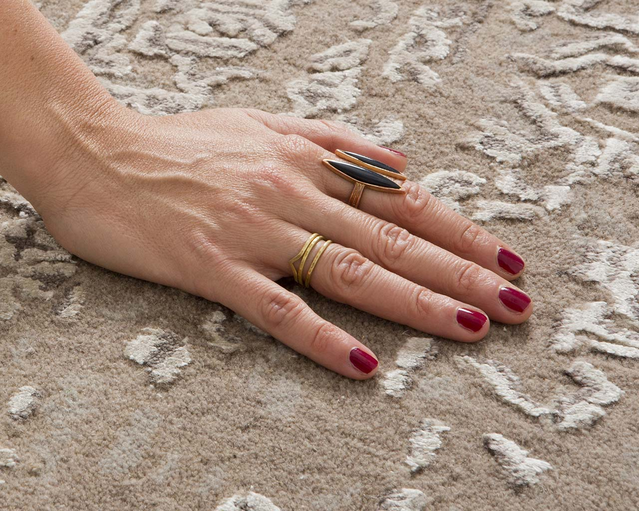 silver tufted hand with nail polish hand tufted wool carpet