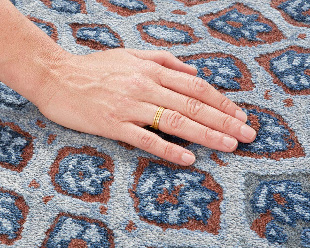 silver tufted hand with ring persian carpet