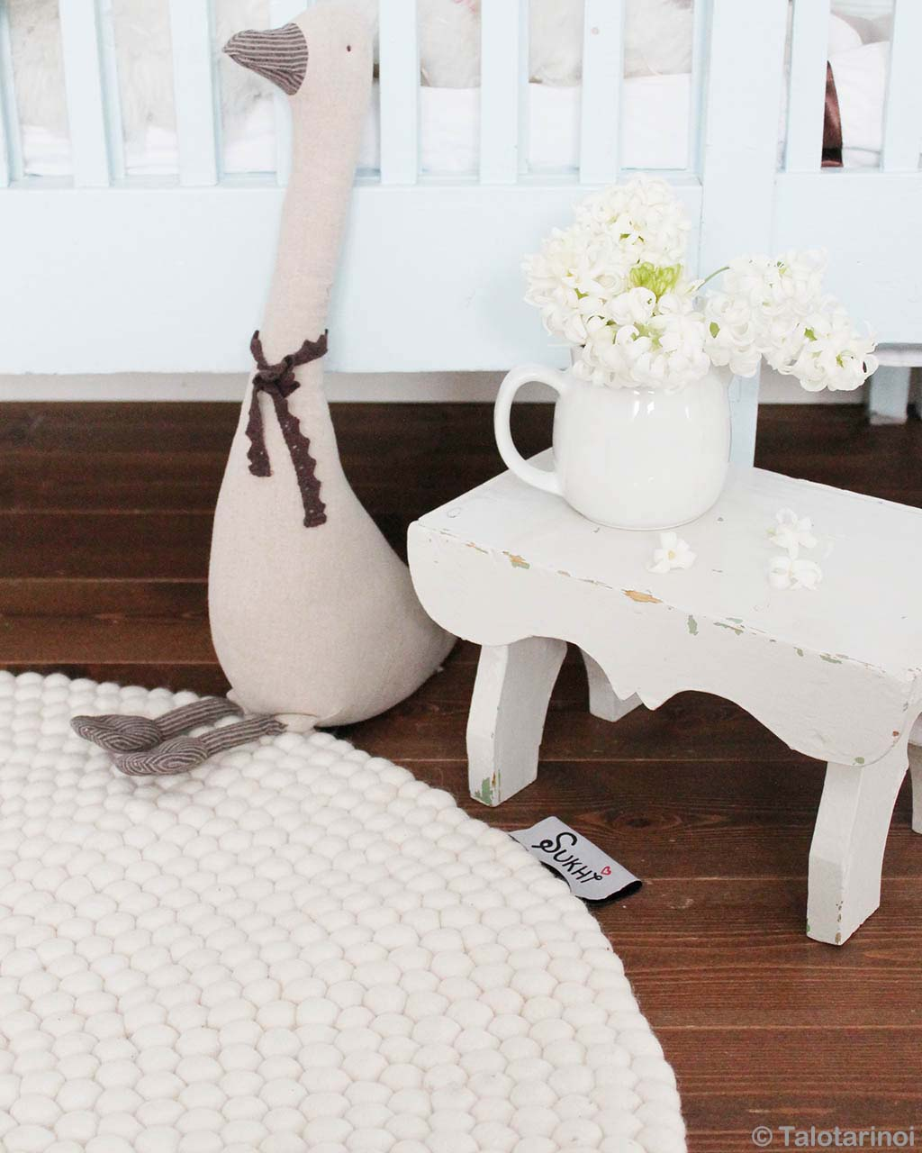 stuffed animal and white vase nepalian made modern rugs