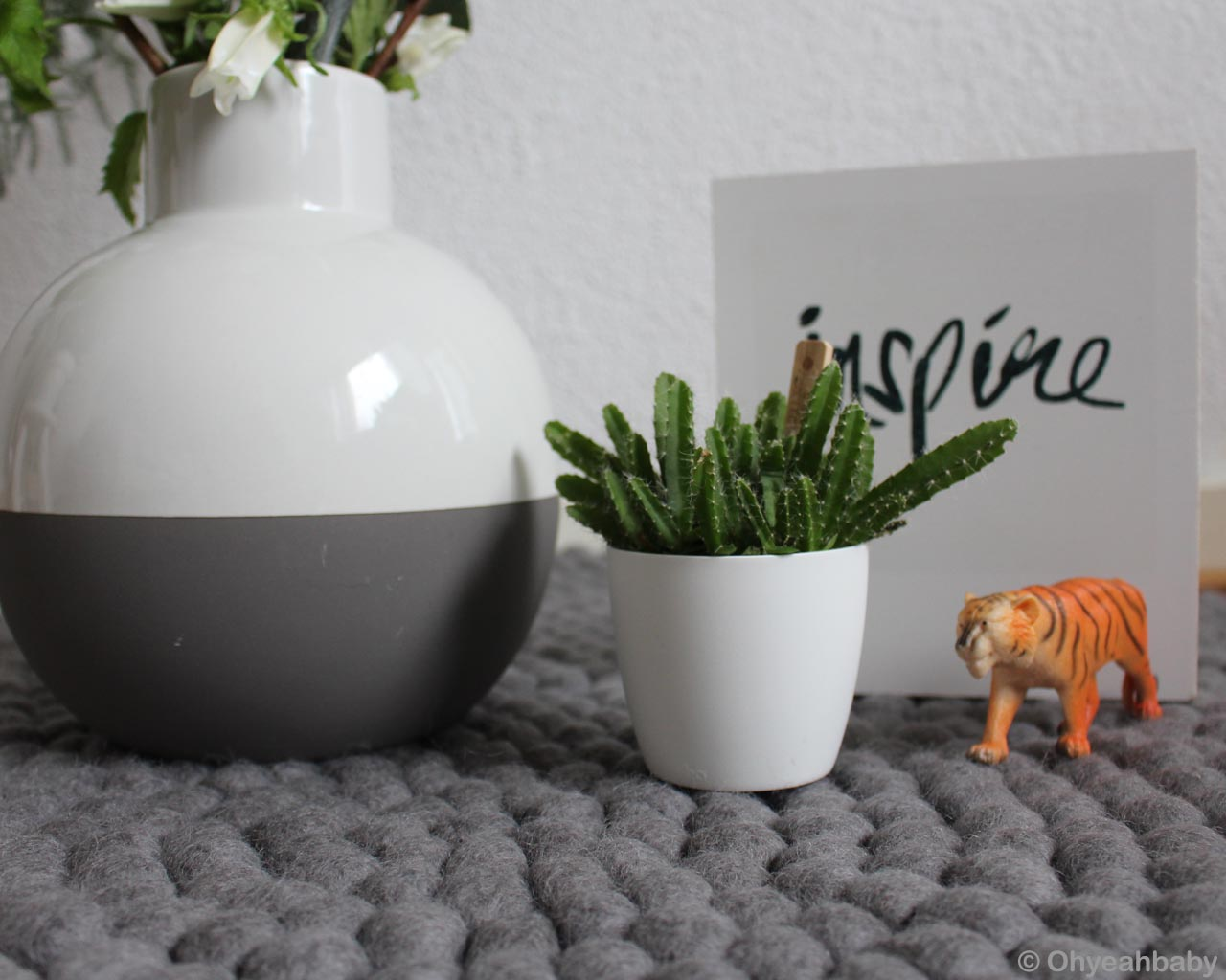 toy tiger and vase with cactus made by nepalian danish design rugs