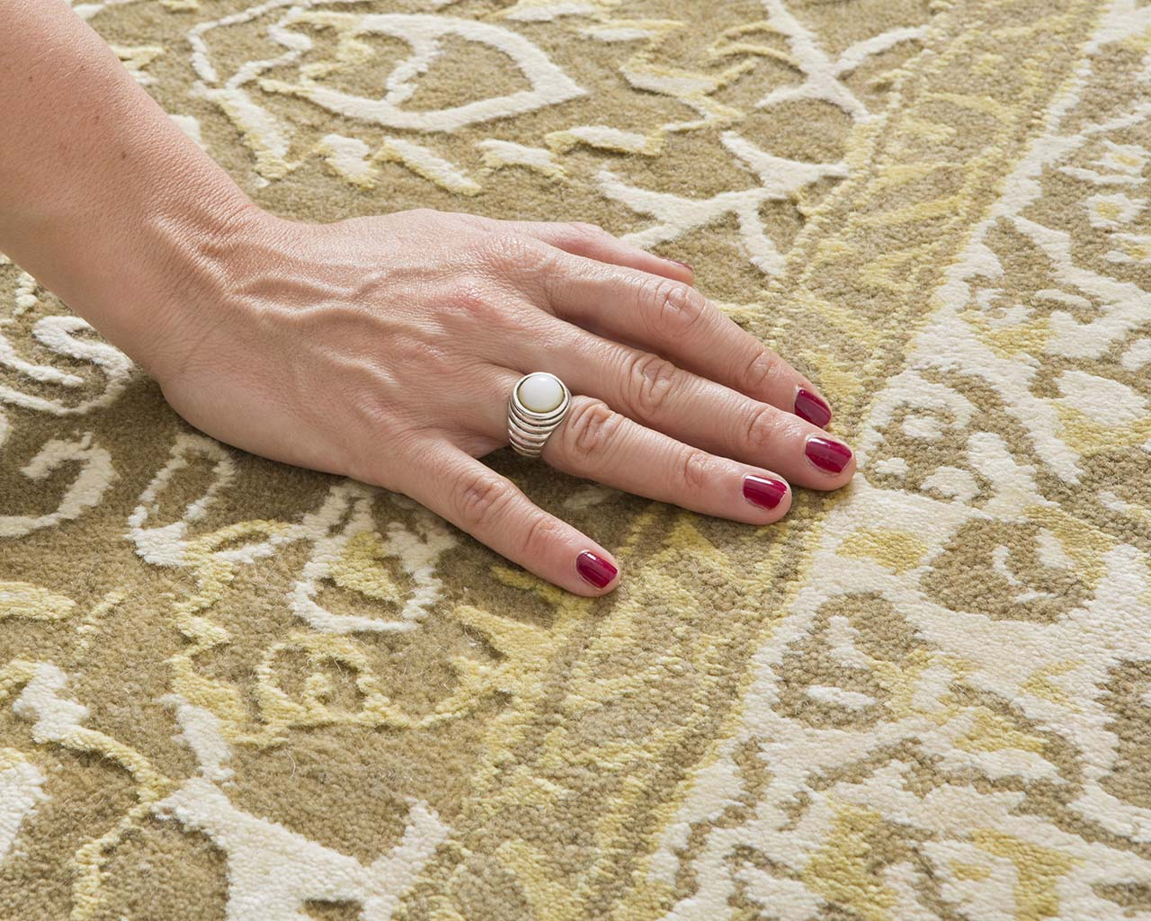 wheat tufted hand with nail polish colorful rugs