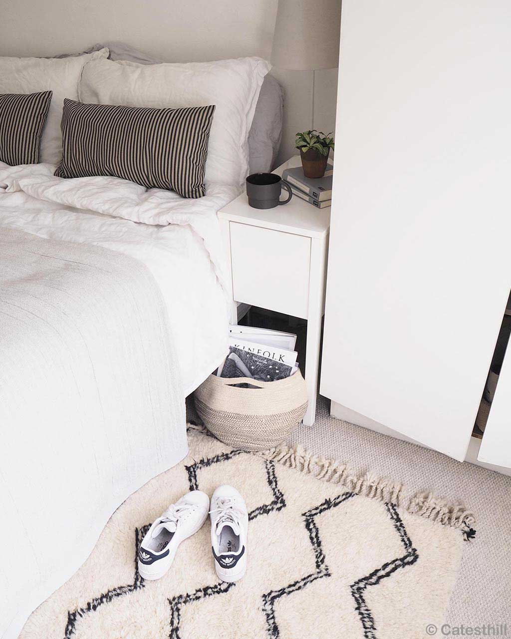 white bed cabinet and white shoes modern rectangular rug