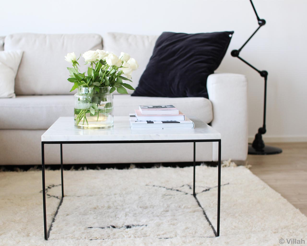 white sofa with black and white cushion from morocco modern accent rug