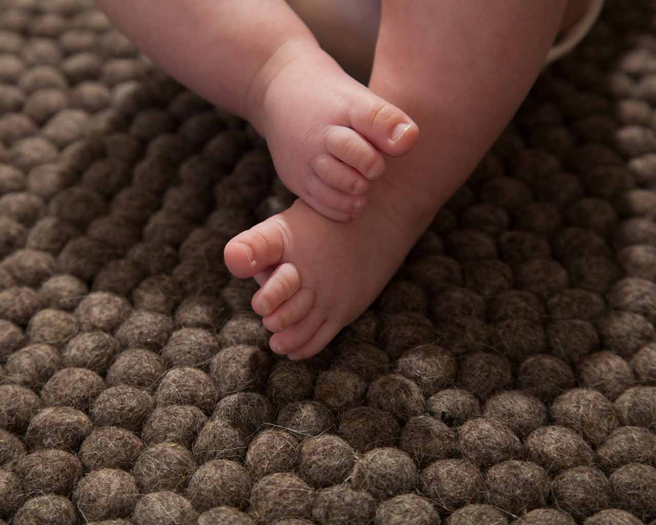 baby feet dark brown felt rug