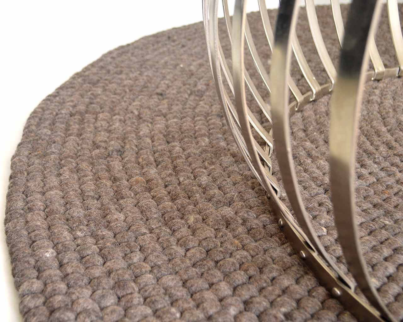 metal table raw earth rug