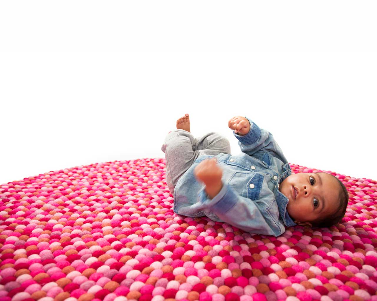 little boy on hot magenta carpet