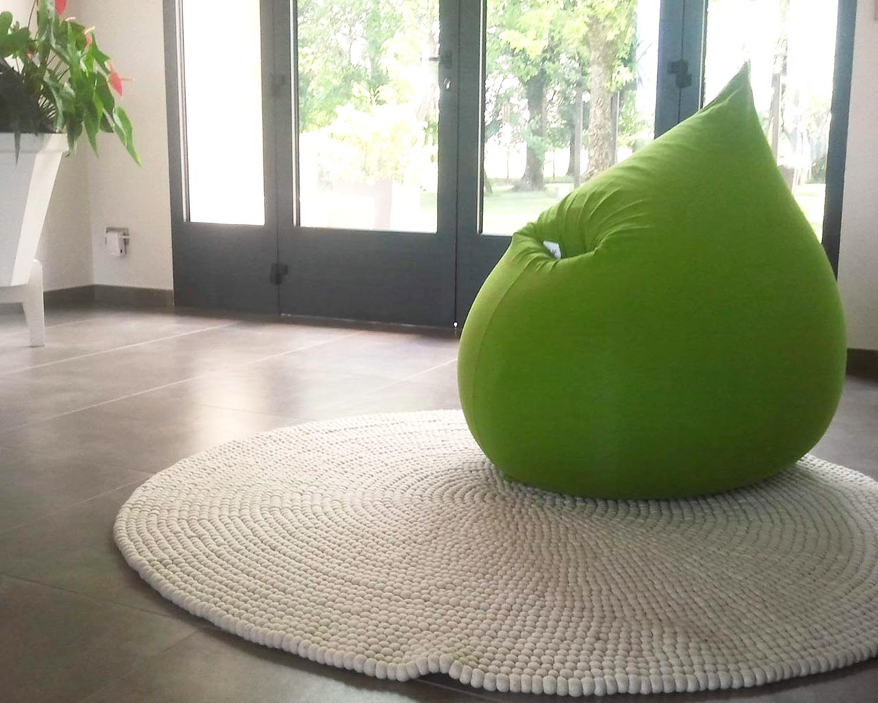 green pouf white rug grey floor