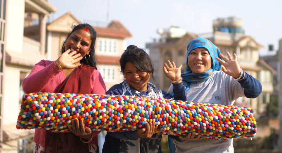 our-team-nepal-felt-ball-rug